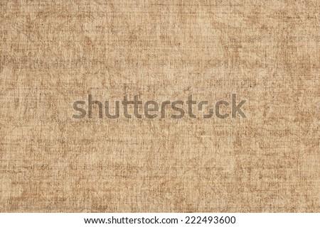 Photograph of unprimed Linen Duck, coarse grain canvas, mottled grunge texture sample. - stock photo