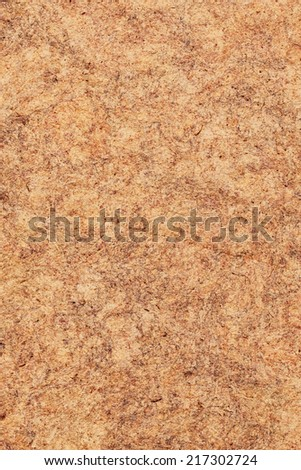 Photograph of vivid Red Ocher recycle paper, extra coarse grain, crumpled, mottled grunge texture sample. - stock photo