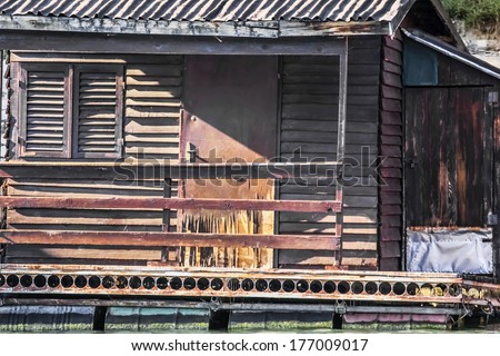 Photograph represents detail of an old, handmade wooden hut, placed among many, side by side, along the Sava river banks, Belgrade - Republic of Serbia.
