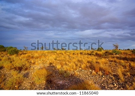Photograph taken from the Sturt Highway in the Mallee Desert under a rare stormy sky, including the long silhouette of the photographer (South Australia). - stock photo
