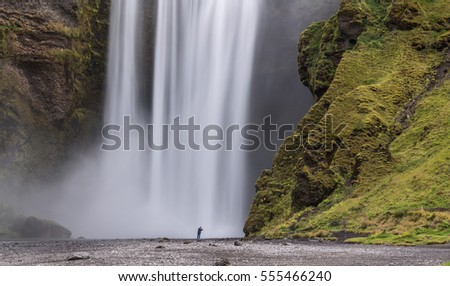 photographer at Skogafoss waterfall, Iceland