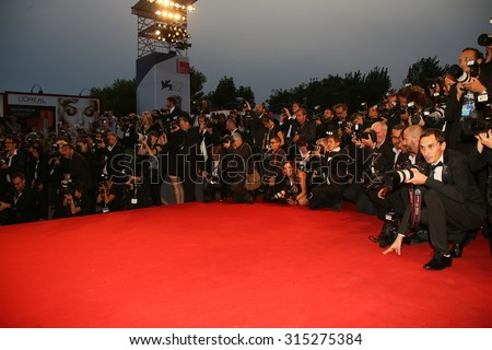 Photographer attend the premiere of the movie 'BLACK MASS' during the 72nd Venice Film Festival on September 4, 2015 in Venice, Italy. - stock photo