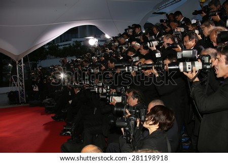 Photographer attends a photocall for the winners of the Palm D'Or during the 68th annual Cannes Film Festival on May 24, 2015 in Cannes, France. - stock photo