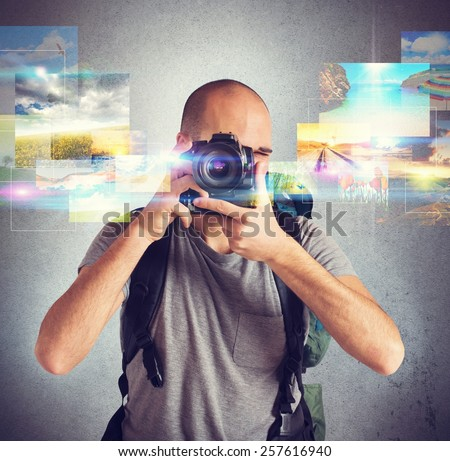 Photographer boy shows his passion for photography - stock photo
