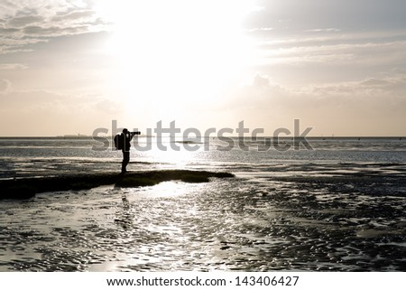 photographer during sunset
