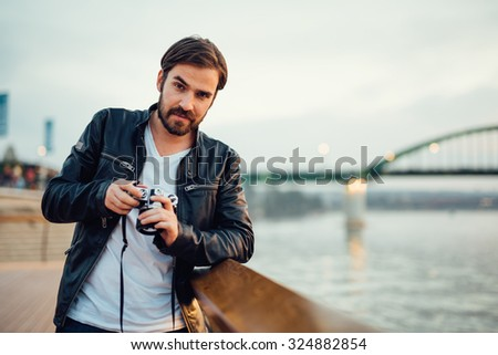 Photographer holding an old film camera