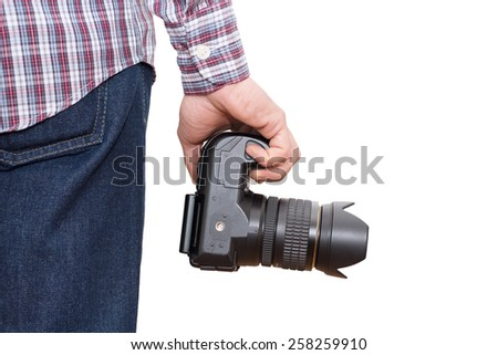 Photographer holding camera near the legs - on white background - In this photo the logos, brand, or anything that can bring to a particular object has been deleted to be 100% commercial. - stock photo