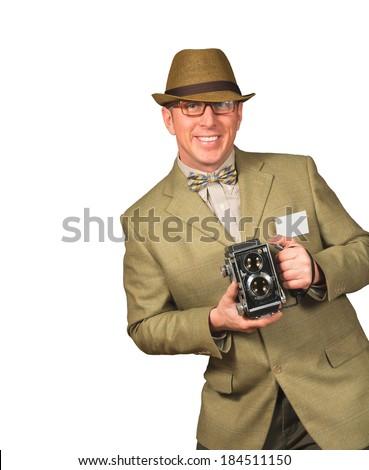Photographer in vintage retro clothing holding old camera isolated - stock photo