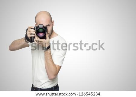 Photographer in white studio - stock photo