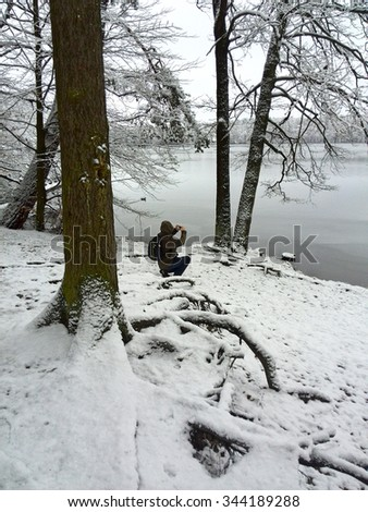 Photographer in Winter - stock photo