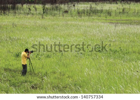 photographer making pictures of flowers