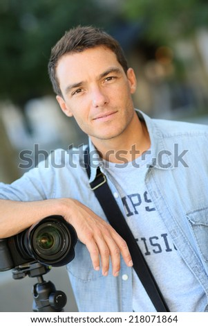 Photographer on a shooting session outside - stock photo