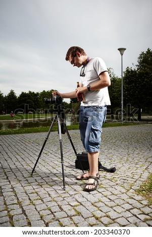 Photographer on location - stock photo