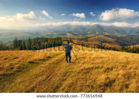 Shot Young Woman Looking Landscape While Stock Photo - This man hikes up the transylvanian mountains every morning to photograph sunrise