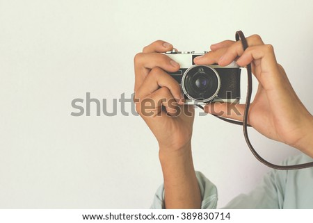 Photographer shooting - vintage and retro filter effect style - stock photo