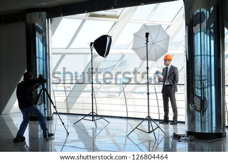Photographer shoots architect - stock photo
