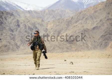 Photographer soldier with camera - stock photo