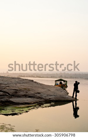 Photographer sunset at rock holes Stone View Sam Pan Bok Grand Canyon in thailand - stock photo