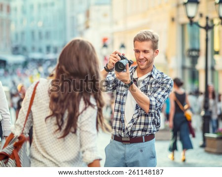 Photographer takes pictures of a young girl