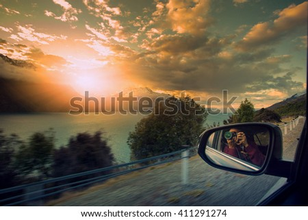 photographer taking a photo on the way to beautiful destination - stock photo