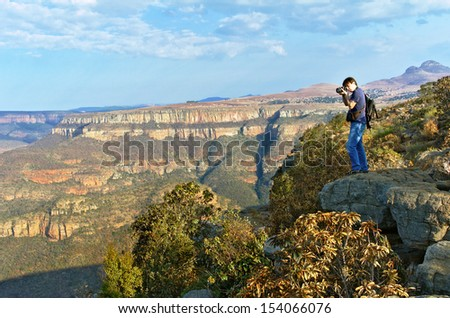 Photographer taking photo of beautiful view of Blyde river canyon, nature of South Africa