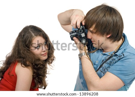 Photographer taking pictures of the young woman. isolated