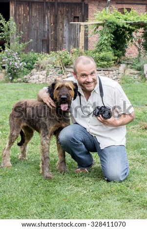 Photographer with big, brown dog / Photographer and dog / pet