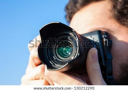 Photographer with camera - stock photo
