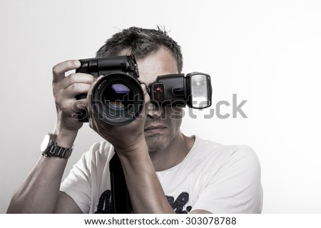 photographer with camera and speedlight