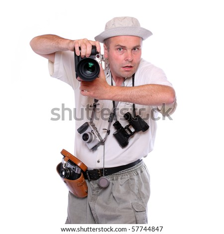 Photographer with cameras dressed on safari suit. Studio shot isolated on white