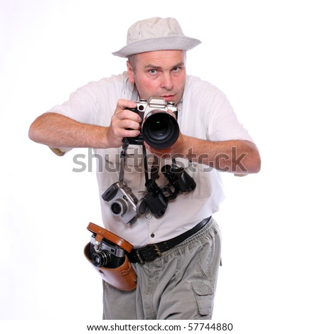 Photographer with cameras dressed on safari suit. Studio shot isolated on white - stock photo