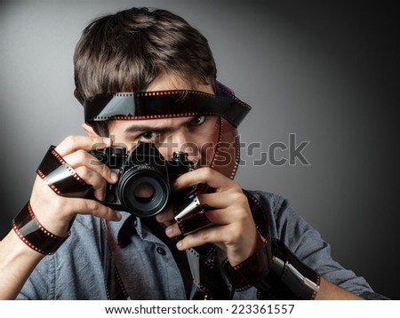 photographer with film camera