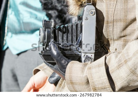 photographer with old camera - stock photo