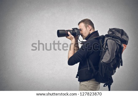 photographer with professional camera - stock photo