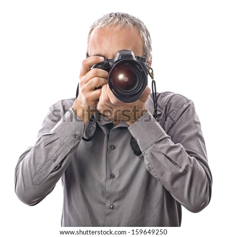 Photographer with professional camera on white