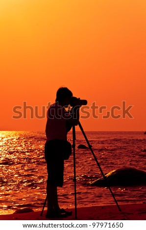 Photographer with sillouette in Hua Hin Beach - stock photo