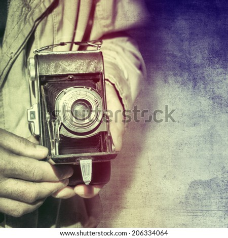 Photographer with vintage camera