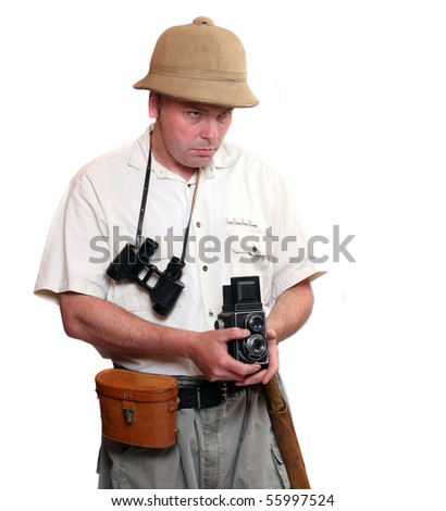 Photographer with vintage TLR camera dressed on suit for tropical destination. Studio shot isolated on white background. - stock photo