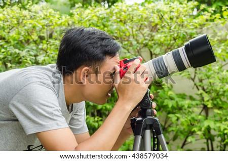 Photographers are shooting birds. - stock photo