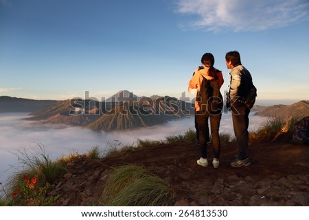 Photographers in Bromo, Indonesia on May 12,2013 : An unidentified photographers at view point .Mount Bromo is part of the Tengger massif, it's not highest peak of the massif, but the most well known - stock photo