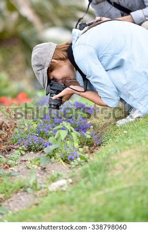 Photographers in park shooting vegetation