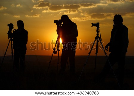 Photographers sunset silhouette
