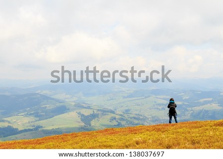 Photographers take pictures of spring view from the top of the mountain Gemba in the Carpathians