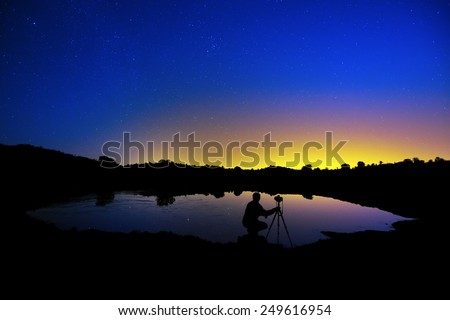 Photographers under the stars - stock photo