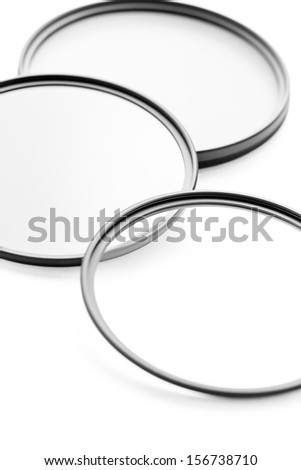 Photographic camera equipment filter on white seamless background
