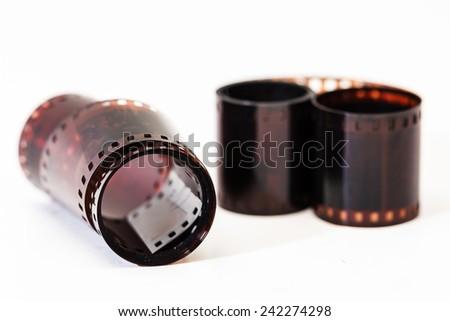 Photographic film. Film reel on white. - stock photo