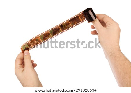Photographic film (my photos) in hands isolated on white background - stock photo