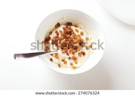 Photographic Recipe of Cottage Cheese Pancakes, Syrniki. Step 4: Add Some Raisins, Stir, Mold Pancakes, Dust With Flour and Fry in a Pan. - stock photo