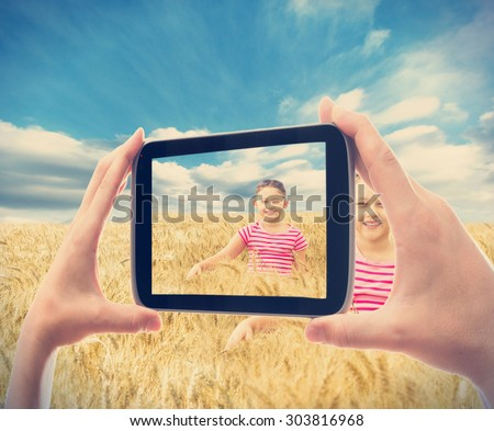 photographing smartphone kid in wheat - stock photo