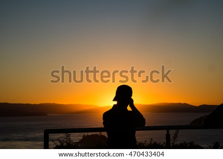 photographing the sunset in silhouette
